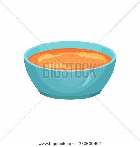 Curry Or Spicy Orange Sauce In Bright Blue Ceramic Dip Bowl. Gravy For Various Dishes. Cooking Ingre
