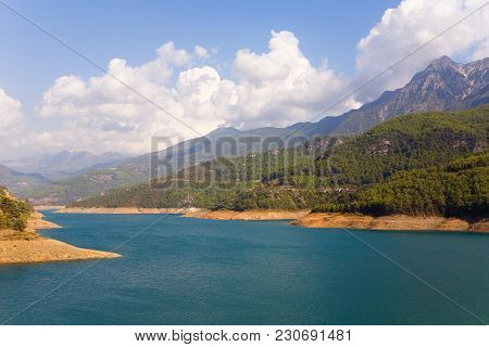 Reservoir And Mountains In The Background. Turkish Alanya.