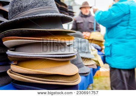 Stacked Various Colored Men Hats For Sale, Available At Flea Market.