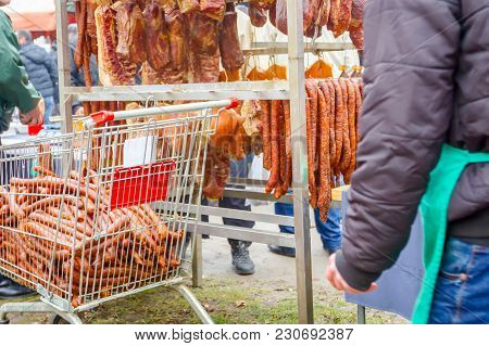 Cured Meat And Sausages Hang For Sale At Outdoor Flea Market, Retail Pushcart.