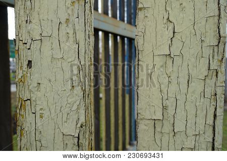 Board Fence With Weathered Pale Yellow Paint