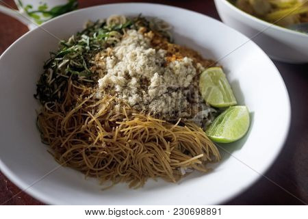 Local Food In South Of Thailand. Local Food Consisting Of Rice, Noodle, Herb, Lemon, Fish Meal, Chil