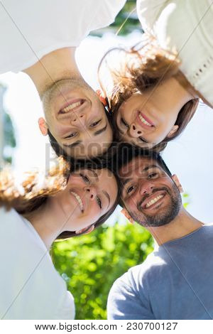 Four friends smiling outdoor
