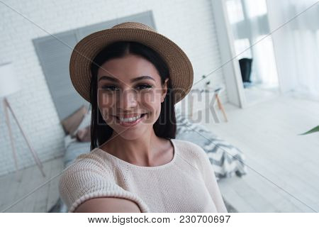 Selfie Time! Beautiful Young Woman Looking At Camera With Smile And Making Selfie While Standing Ind