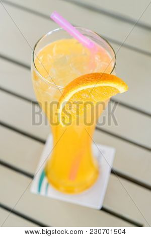 Orange juice from fresh orange in glass