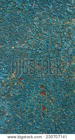 Old Rusty Metal Background With Blue Paint Flaking Texture.