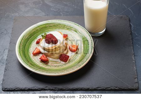 Stack Of Pancakes With Ripe Strawberries And Pouring By Jogurt.