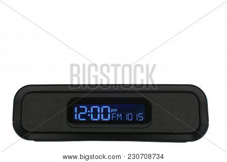 A Black Clock Radio Set To Fm Station