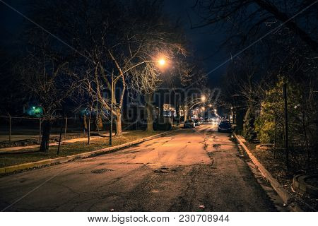 Dark and eerie urban city street at night