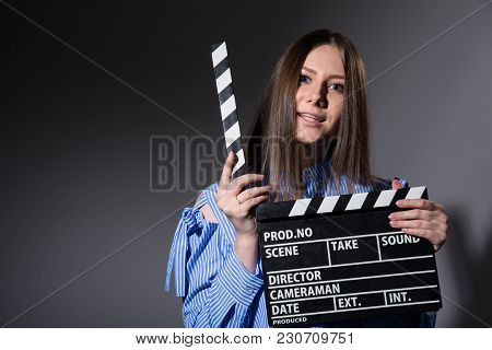 Young Woman With Movie Clapper.