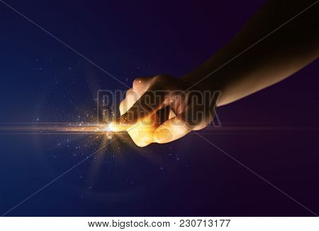 Female finger touching a beam of light