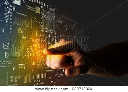 Female finger touching a beam of light surrounded by charts and graphs