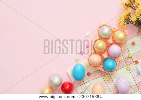 Flat Lay Top View Colorful Easter Egg Painted In Pastel Colors Composition And Spring Flowers On Pin