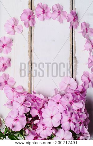 Frame Of Flowers Laid Out On The Table