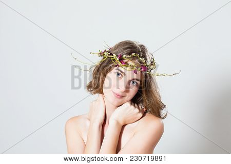 Tenderly Beatiful Woman In Early Spring Garland. Symbol Of Youth And Beauty