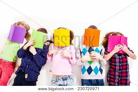 Children Are Lying And Sleeping. They Are Reading Very Boring Books. Concept Of Problems In Educatio