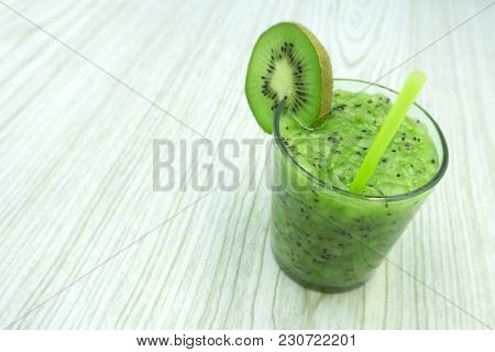 Kiwi Juice With Fresh Fruits On Blue Wooden Table