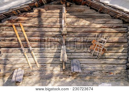 Doors Of An Old Barn On A Cold Winter Morning In The Beautiful Town Of Zinal, Switzerland. These Typ