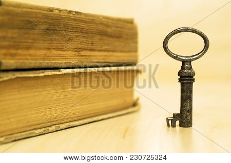Key And Books - Life Coaching And Motivation Concept