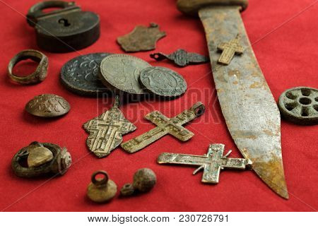 A Lot Of Ancient Copper And Iron Objects On A Red Background, Personal Items Of The 18th Century