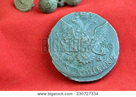 Old Russian Coins Of The 18th Century On Red Cloth