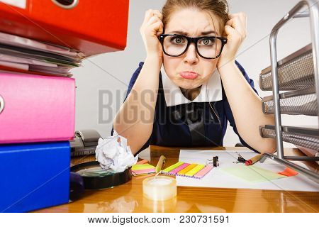 Mobbing At Work, Bad Job Relations Concept. Depressed Businesswoman Being Sad And Tired Sitting Work
