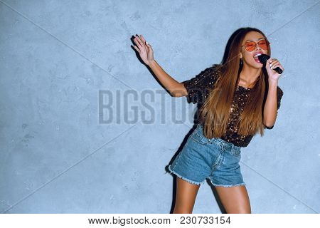 Attractive African American Woman With Microphone Singing Song