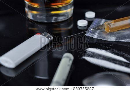 Cocaine, Pills, Alcohol And Heroin In Syringe.