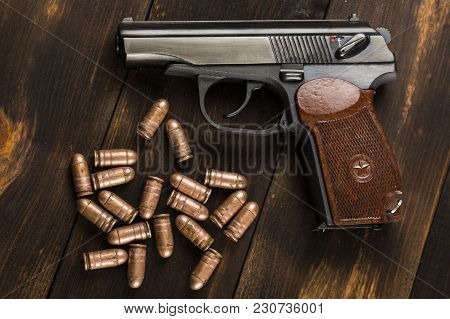 Cartridges For A Makarov Pistol On A Wooden Table