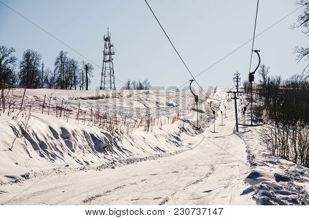 Cellular Tower In The Winter Forest In The Mountains