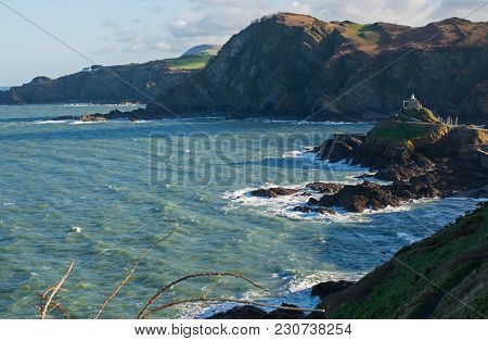 Coastline And Harbour Entrance At Ilfracombe In Devon, England