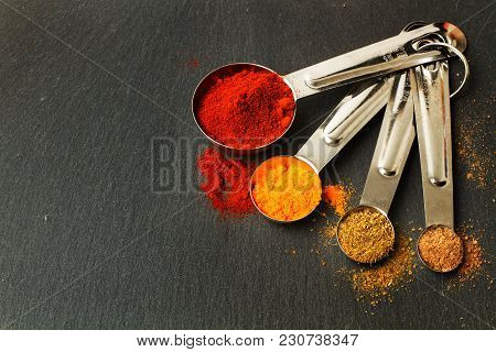 Stainles Steel Spoons To Measure Cooking Ingredients Whit Spices