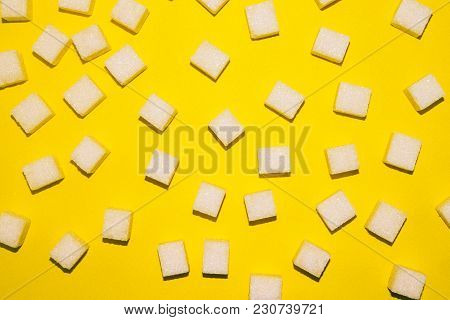 Top View Of White Sugar Cubes On Bright Yellow Background