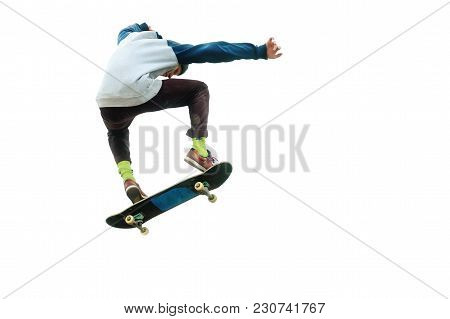 A Teenager Skateboarder Jumps An Ollie On An Isolated White Background. The Concept Of Street Sports