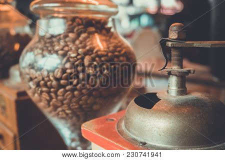 Ancient Coffee Grinder And Glass Jar With Coffee Beans Inside.coffee Bean Grinding In Coffee Blender