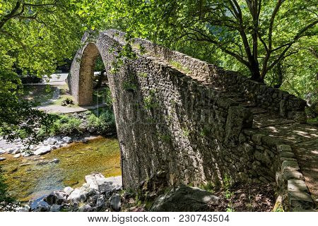 The Old Stone Bridge Of Pyli Village In Thessaly, Greece