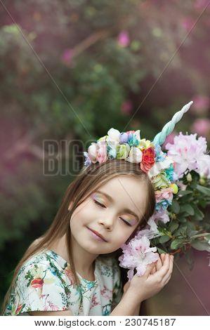 Fantasy Little Girl With Rainbow Unicorn Horn With Flowers In Azalea Park