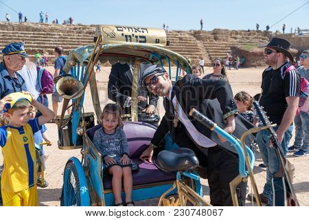 Caesarea, Israel, March 03, 2018 : A Participant Of The Purim Festival Posing With A Visitor In Caes
