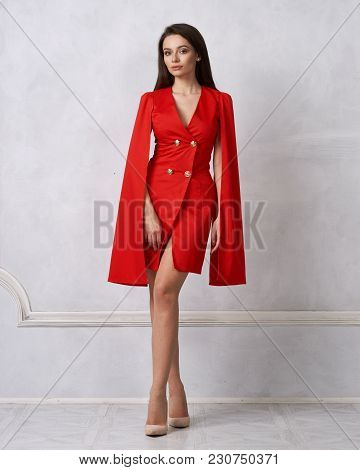 Attractive Brunette Female Model Wearing Mini Red Dress With Golden Buttons, Split, Long Hanging Sle