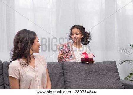 Happy African American Daughter Presenting Gifts To Mother On Mothers Day