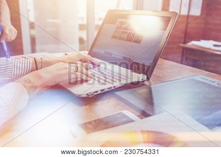 Close-up View Of Interior Designer Workspace With Laptop, Graphic Tablet, Phone And Color Palette On