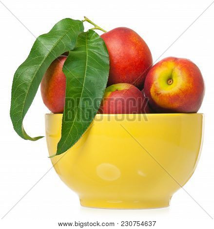 Ripe Nectarines In The Yellow Bowl Isolated On A White Background