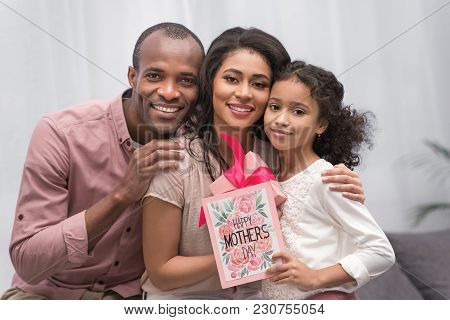 Happy African American Parents And Daughter Looking At Camera On Mothers Day