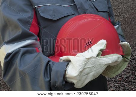 A Helmet For Protection .   Working Gloves. Female Hard Work.  Dangerous Production . Labor Protecti