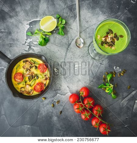 Green Smoothie With Spinach, Vegetarian Omelet, Tomatoes And Pumpkin Seeds. Flat Lay, Top View.
