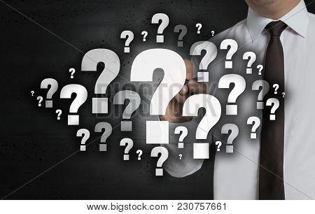Question Mark Cloud Is Written By Businessman On Computer Screen.