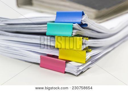 Stack Of Papers Documents In Archives Files With Paper Clips On Desk At Offices, Business Concept.