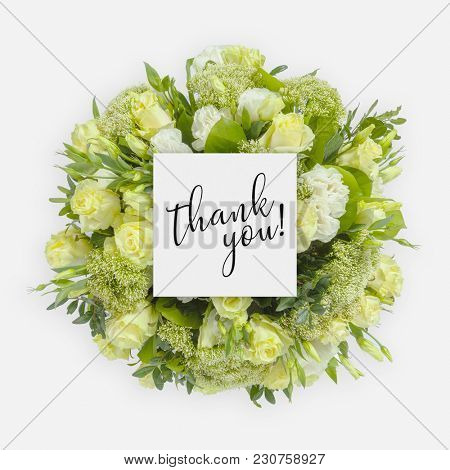 Fresh flowers bunch and card with words thank you written on it