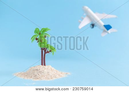 Desert Island And Airplane Model Toy On Pastel Blue Background Minimal Concept
