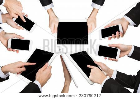 Set Of Caucasian Businessman Hands Holding Tablet And Smartphone, Showing Symbols And Gestures, Poin